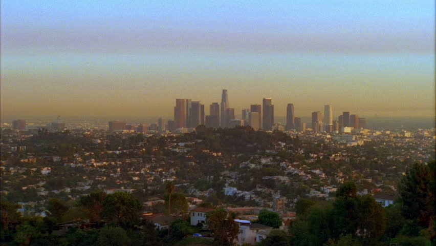 Day SUNSET High angle Panorama Push over city basin Los Angeles skyline | Shutterstock HD Video #21328033