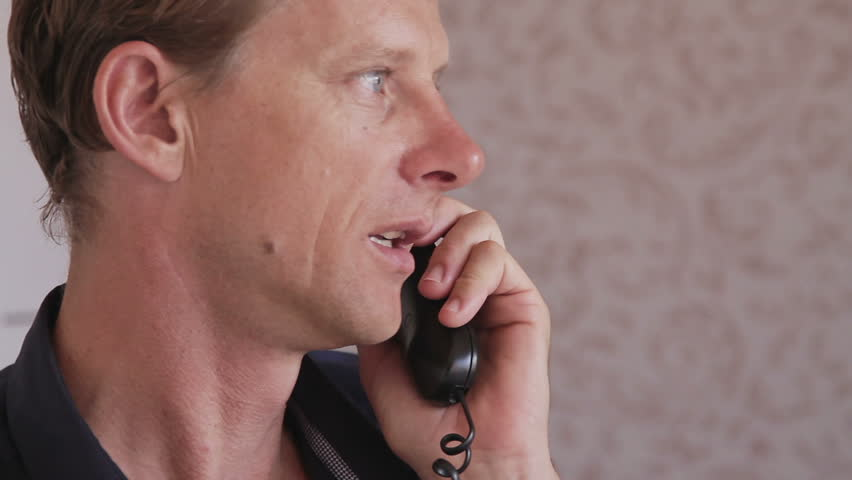 Pleasant adult male talking on telephone - HD stock video clip