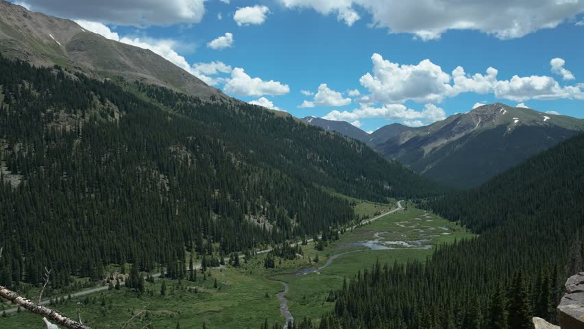 Summertime Mountain puffy clouds timelapse at Independence Pass