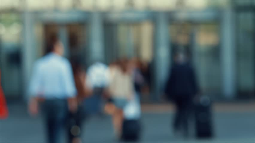 Businessmen crowd near the entry into the business center. People going to work. Concept for finance, job and economy. Modern buildings in business district. Action by day. Focus blur. Toned | Shutterstock HD Video #21600067