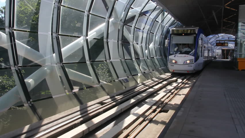 THE HAGUE, HOLLAND - JULY 15: RandstadRail tram rides through a modern elevated tunnel on July 15, 2011 in The Hague, Holland. RandstadRail network connects The Hague, Zoetermeer and Rotterdam.  - HD stock video clip