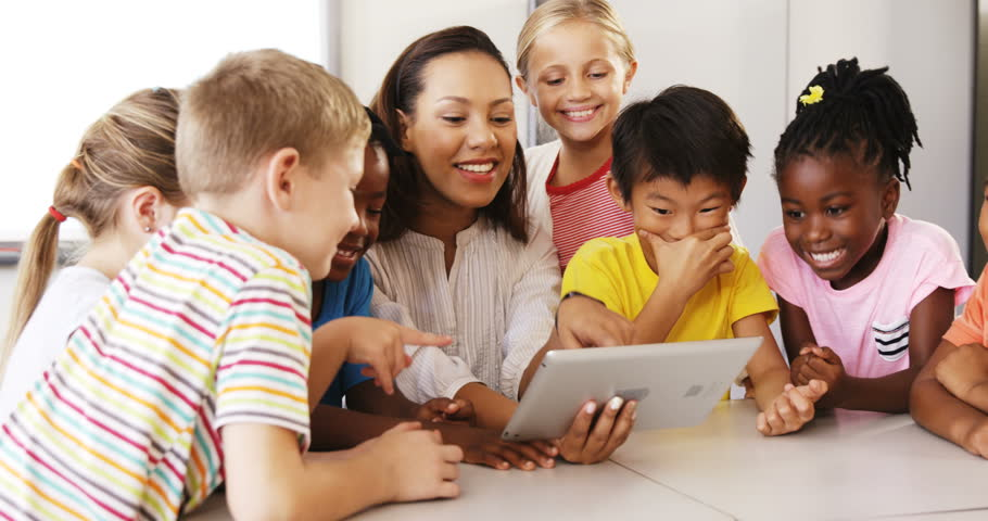 Teacher teaching school kids on digital tablet in classroom at school   Shutterstock HD Video #21730702