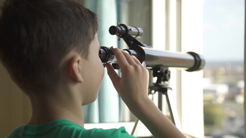 The Boy Looks in the Telescope Through an Open Window #21746272