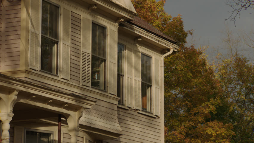 Day side upstairs windows beige wood clapboard house , dormers, autumn, fall trees, breezy (Oct 2012)