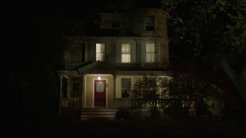Night beige wood clapboard housr , wrap around porch, dormers, bay windows, lights on, autumn, fall trees, see guest house r background , upstairs lights turn then lights turn then (Oct 2012)
