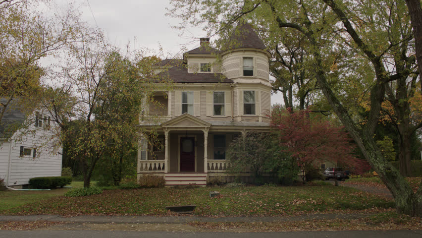 Day beige wood clapboard house , wrap around porch, bay windows, turret, dormers, red screened door, autumn, fall trees, SUV by, (Oct 2012)