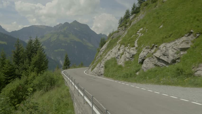Beautiful aerial shot of a vehicle on the Swiss Alpine road  | Shutterstock HD Video #21821341