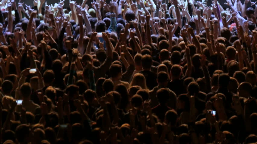 A crowd of people at a rock concert. Fans gather in front of the performance of a rock band. | Shutterstock HD Video #21825742