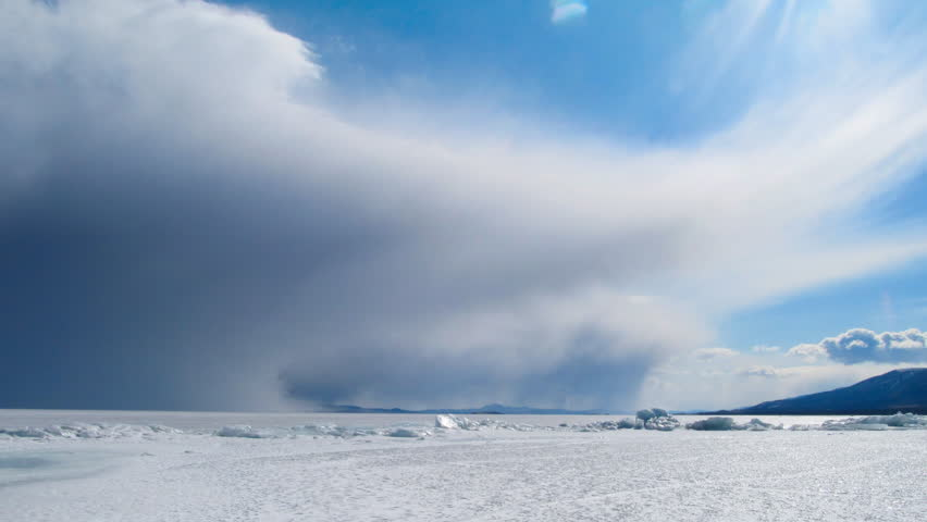 Winter Baikal landscape. Ice and clouds