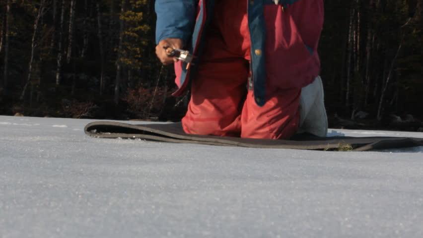 Fisherwoman at ice fishing. Women fishing, women's way of playing jig (trolling). | Shutterstock HD Video #22045432