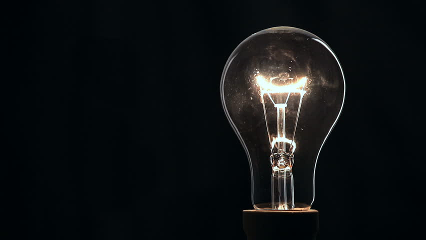 Light bulb on black background.   Shutterstock HD Video #22056466