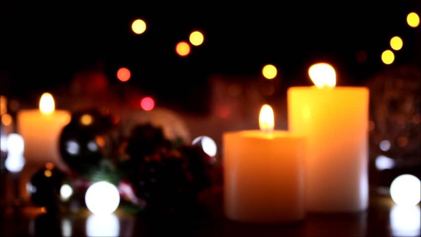 Blurred Christmas decoration background with burning candles. Burning white candles