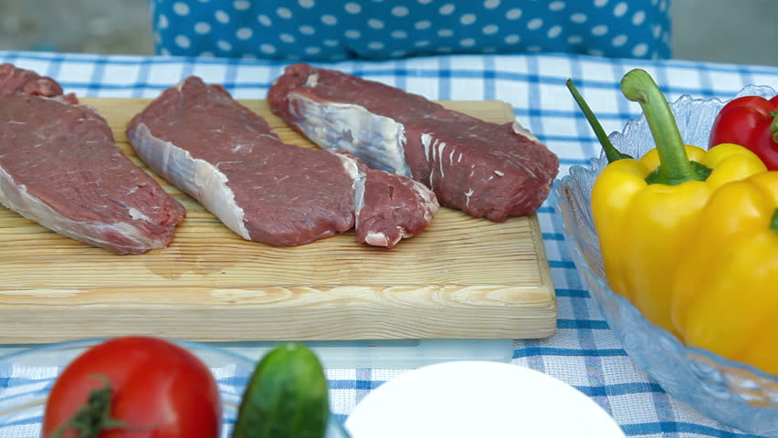 Preparing beef stack for frying, brushing olive oil