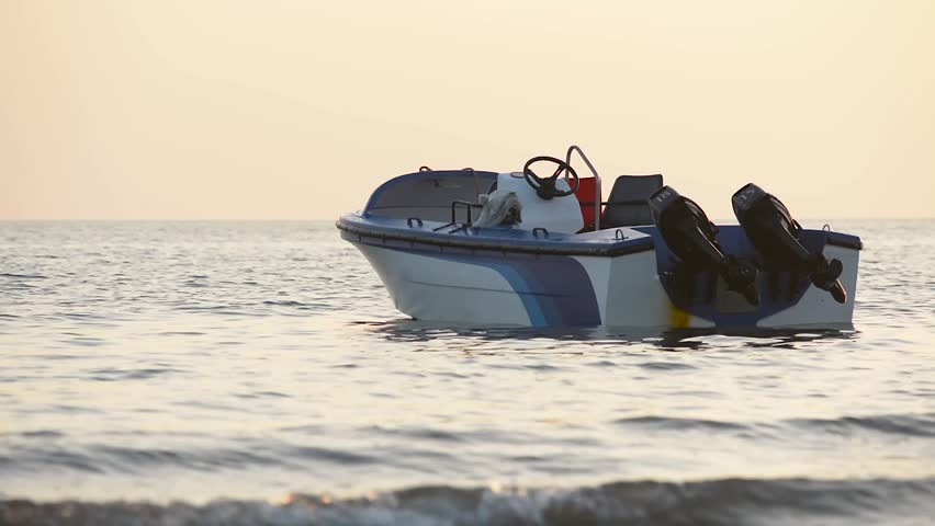 White speed boat floating on waves of sea | Shutterstock HD Video #22074997