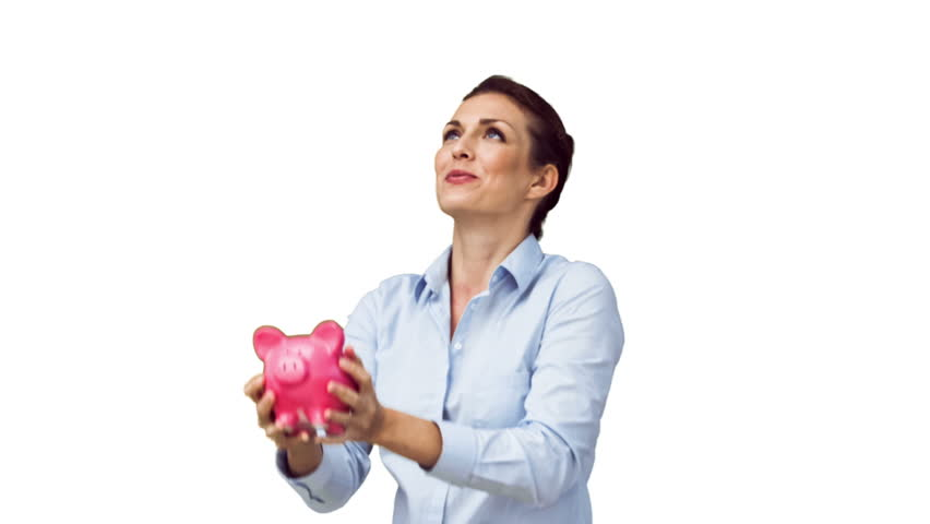 Woman in slow motion throwing her piggy bank against a white background in slow motion