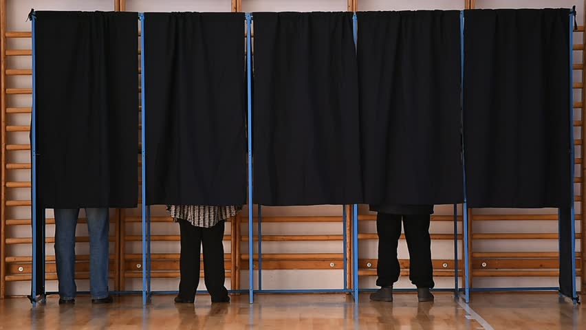 Unrecognizable people casting votes into the ballot box during elections | Shutterstock HD Video #22140832