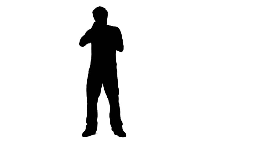 A silhouette man is singing into a microphone against a white background - HD stock video clip