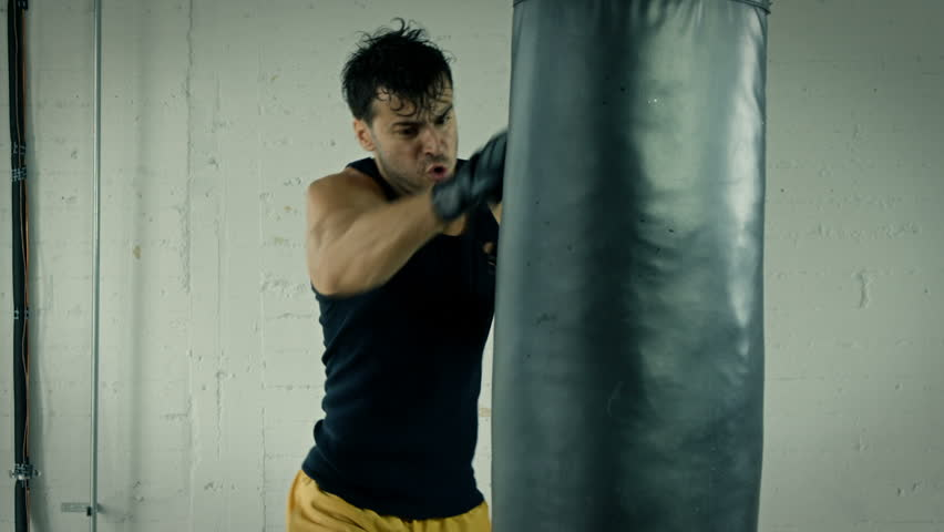 Athletic Male Working Out. Boxing. Slow Motion. | Shutterstock HD Video #22178452