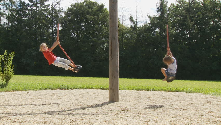 kids on swing at playground part II of II - HD stock video clip