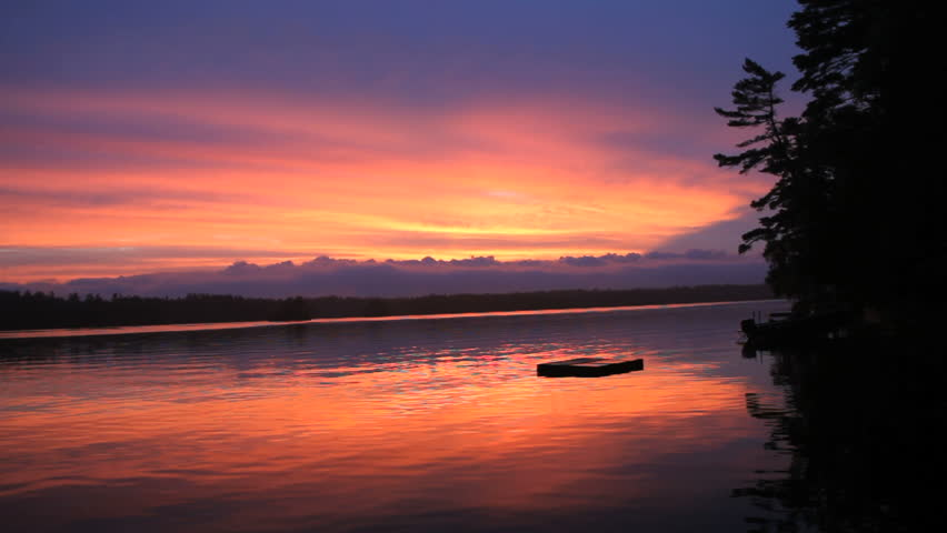 Raft and Lake at Incredible pink and purple peaceful Sunset - HD stock video clip