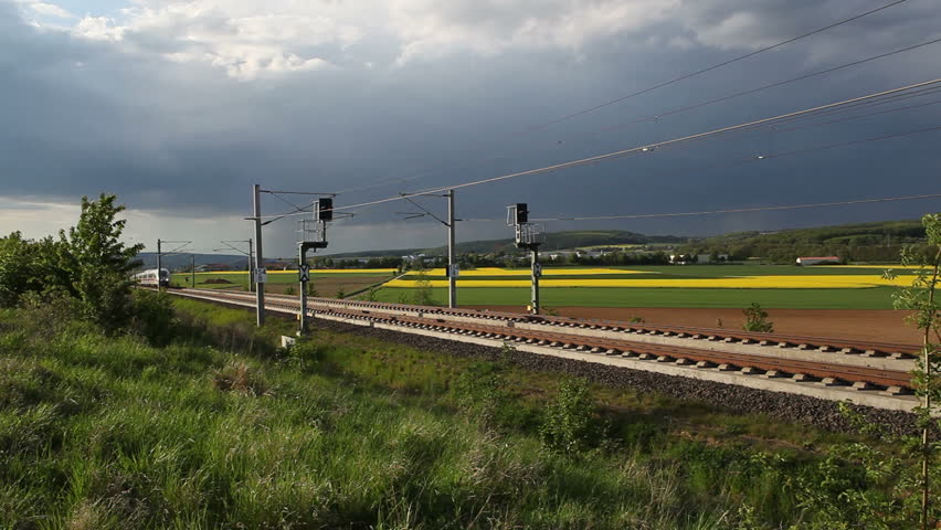 WALLAU, GERMANY  MAY 4: A passing german highspeed train (ICE) on the Frankfurt-Cologne line on May 4, 2012 near Wallau, Germany. The maximum speed of these highspeed trains is around 320km/h.