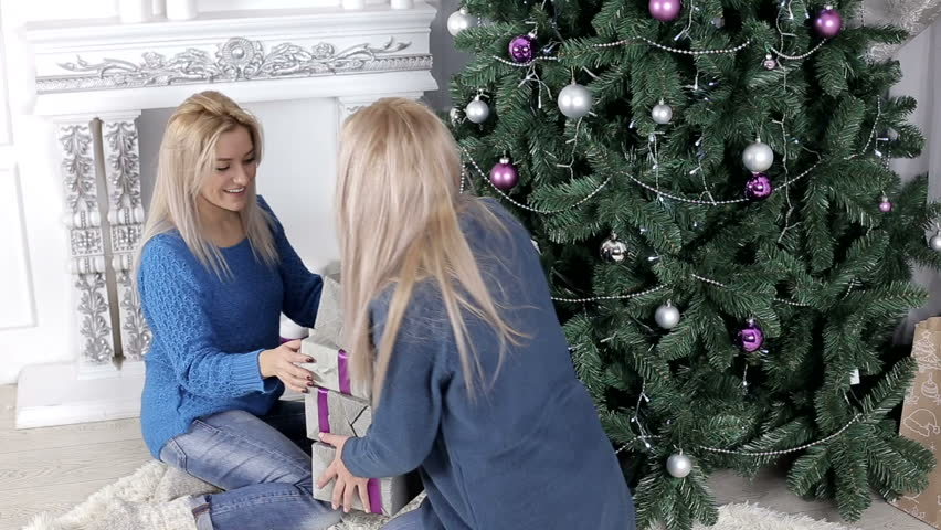 Preparing Christmas tree two gorgeous Blondes, and presents all of them expecting | Shutterstock HD Video #22333441