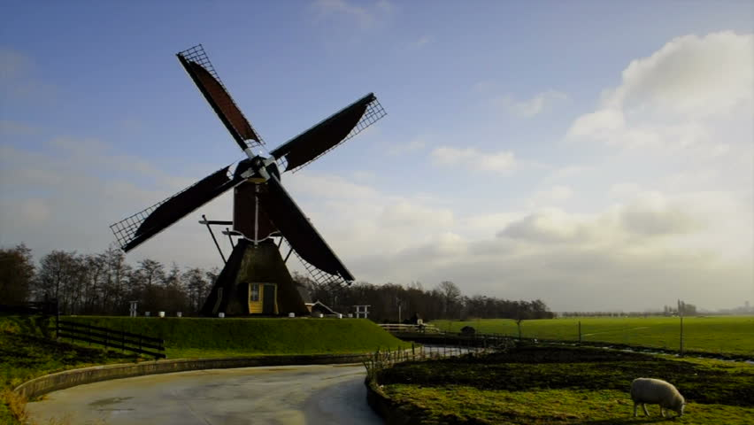 Old windmill in Holland on a windy winter's day. - HD stock video clip