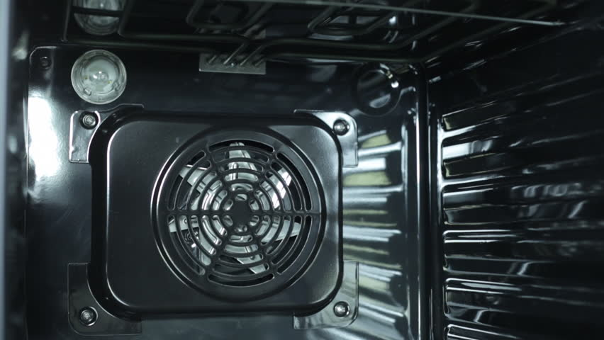 Start working of the oven. The lamp turn on and the fan start working. | Shutterstock HD Video #22460314