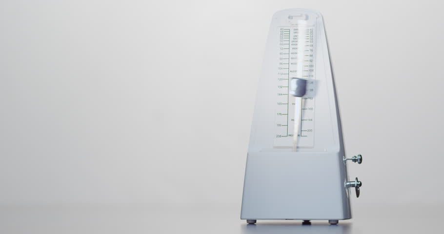 Mechanical metronome produces an audible beat at regular intervals that the user can set in beats per minute. White metronome on white background. | Shutterstock HD Video #22460323