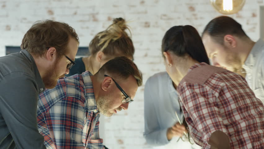 Seven Stylish Diverse People Lean on a Conference Table While Energetically Discussing Daily Business Plans. Shot on RED EPIC (uhd).   Shutterstock HD Video #22522198