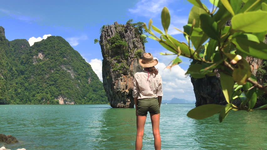 Tourist girl enjoying view of beautiful sea at the famous Khao ping Kan, also known as James bond Island in Phang nga Bay | Shutterstock HD Video #22547020