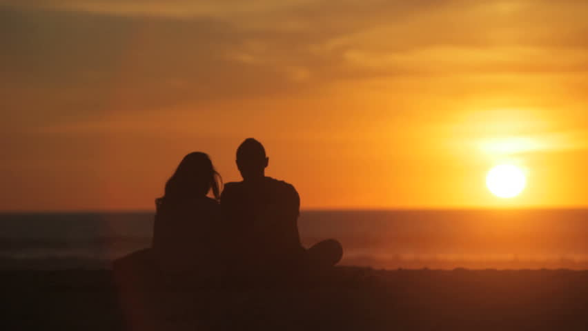 Silhouette of couple during beach sunset - HD stock footage clip