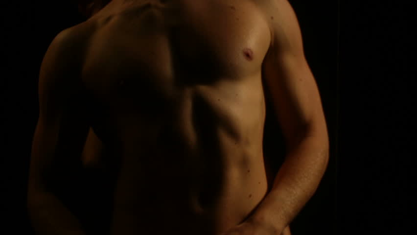 Sport male naked body in the lights breathes on a black background. Young man showing work of muscles of body - torso.  | Shutterstock HD Video #22607887