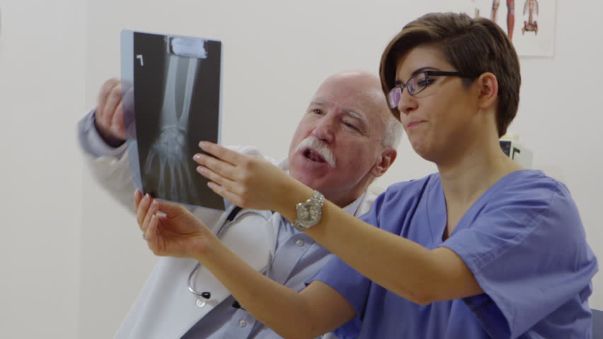 Nurse and elderly doctor discussing x-rays | Shutterstock HD Video #22640278