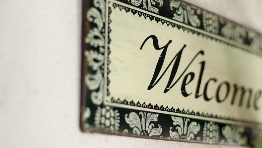 """Wooden board with message """"Welcome"""" in the Hotel 
