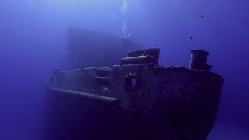 SCUBA Diver on a sunken shipwreck, the USS Kittiwake in Grand Cayman Islands