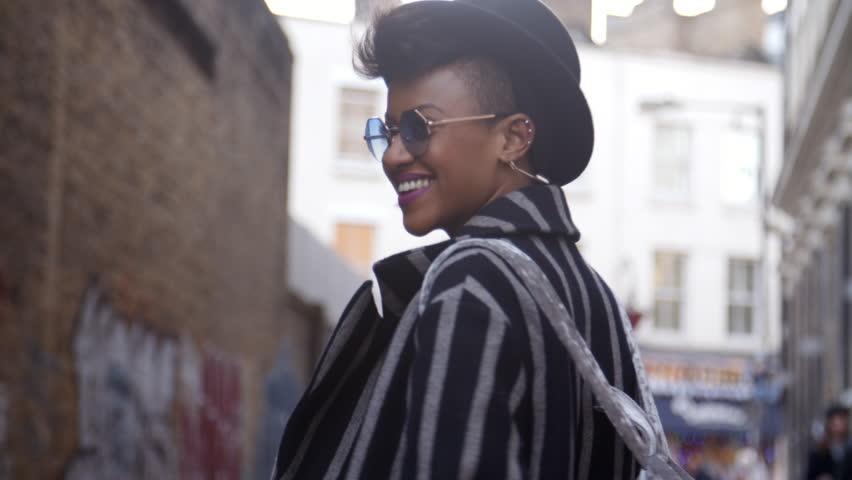 Stylish Fashion Blogger Walking Along Urban Street