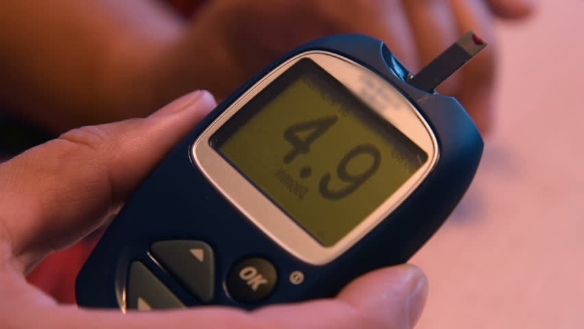 Close-up shot of hand with glucometer showing result of blood sugar level test at home | Shutterstock HD Video #22985770