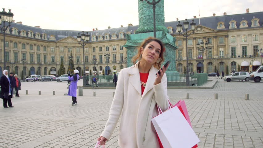 Paris, Woman shopping in Paris on place Vendome, 4K, UHD (3840X2160) | Shutterstock HD Video #23074492
