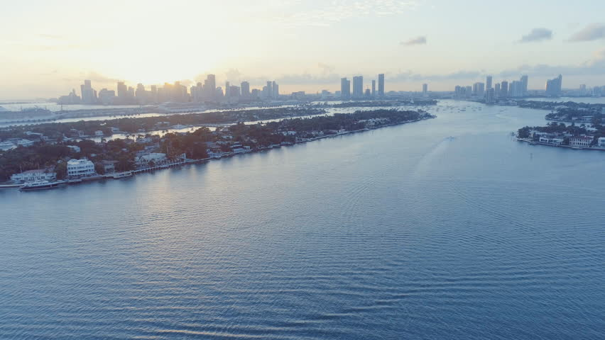 Jet Skis Racing Across Biscayne Bay Miami Beach Florida Downtown Sunset Background Aerial Drone Shot   Shutterstock HD Video #23106838