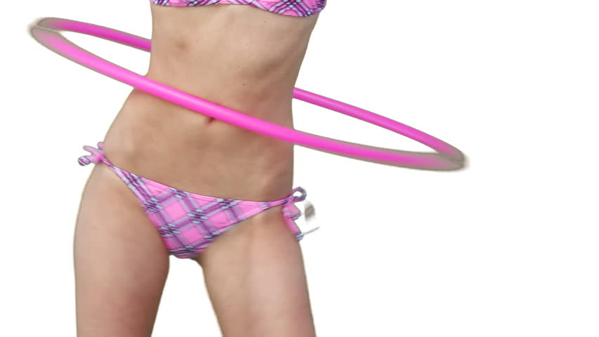Close up of a woman using a hula hoop against a white background - HD stock footage clip