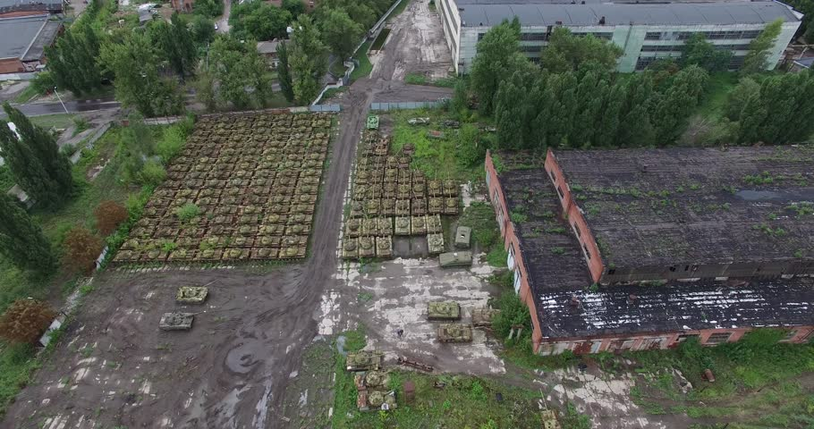 Low flight over the cemetery of military tanks. Many destroyed military tanks is abandoned   Shutterstock HD Video #23107414
