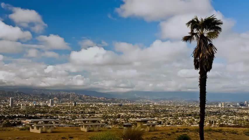 View of Los Angeles From the Large Hill. the Clouds Float Across the Sky and Cast Its Shadow Over the City. Far on the Horizon Visible High Skyscrapers. View of Los Angeles From a Height. Outside the | Shutterstock HD Video #23112355