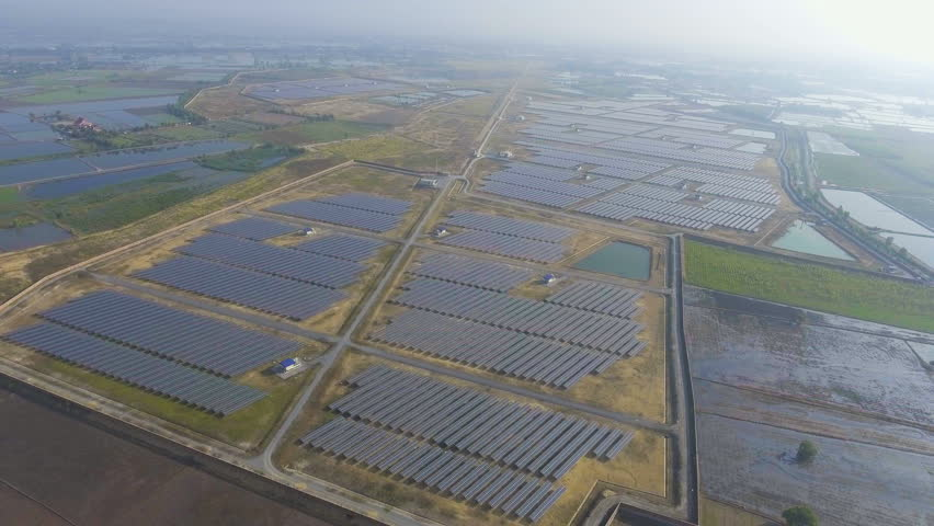 Aerial View of Solar Panels in Solar Power Station with Sunlight. Orbit shot with Drone.   Shutterstock HD Video #23113300
