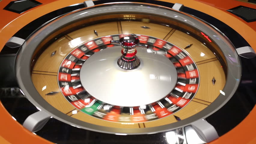 Roulette table in casino. Ball in the rotating gambling machine. Wooden roulette wheel. | Shutterstock HD Video #23122903