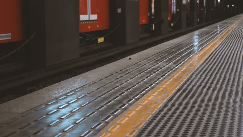 Train arriving at an underground station and people waiting   Shutterstock HD Video #23126566