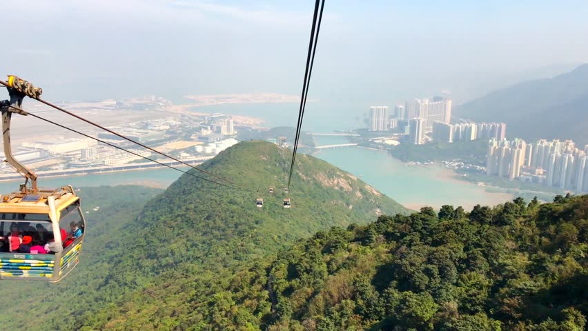 Looking out of window of cable car to see mountain and city harbour view   Shutterstock HD Video #23150623