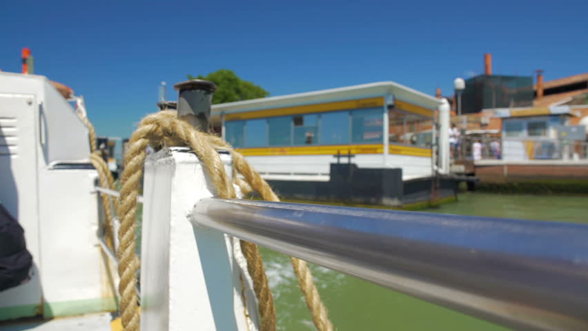 Thick rope tied on board of motor boat cruising canal, water transport services | Shutterstock HD Video #23157823