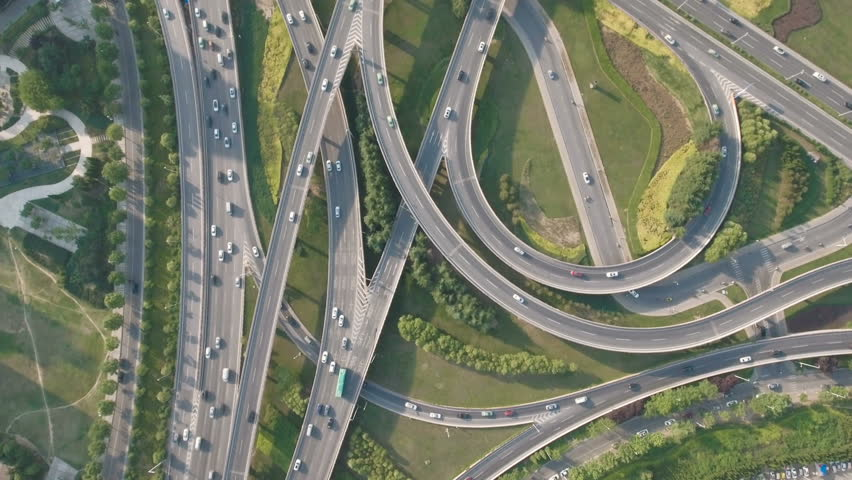 Aerial shot of a massive interchange in Zhengzhou city, infrastructure and transportation in China  | Shutterstock HD Video #23165212