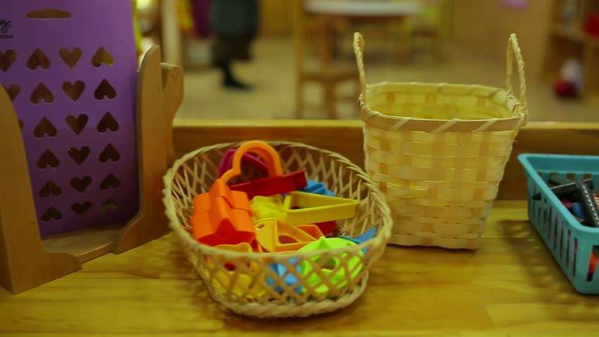 Camera pans right over several baskets with children's art supplies. (Santiago, Chile - Feb 2016) | Shutterstock HD Video #23167561